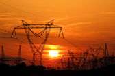 High voltage electric pole during sunset — Stock Photo