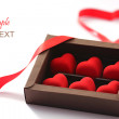 Stock Photo: Red valentines small hearts in brown paper box