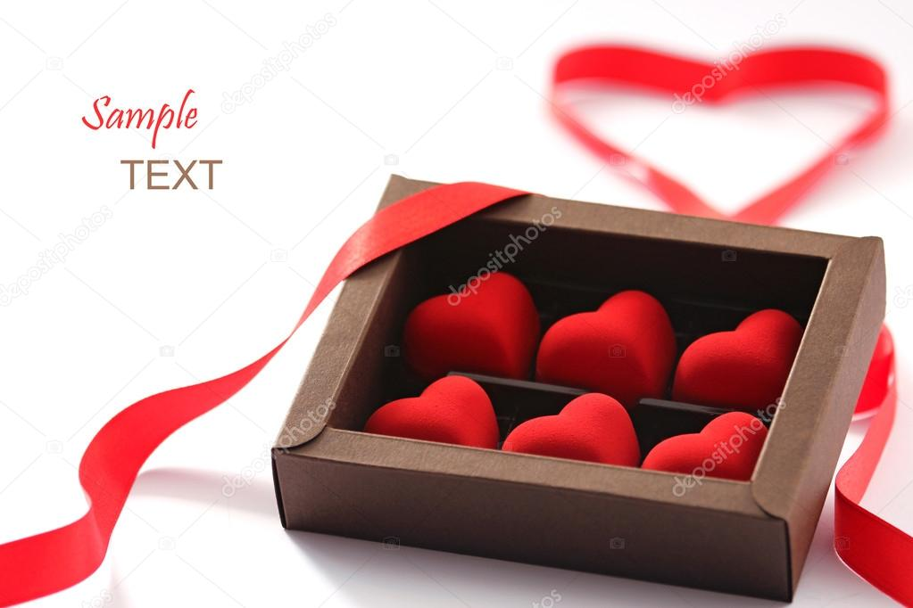 Red valentines small hearts in brown paper box — Stock Photo #15798679