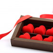 Red hearts in brown box on white background — Stock Photo