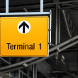 Detail view of terminal sign on airport hall — Stock Photo