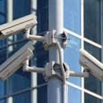 Three cctv security cameras on the street pylon — Stock Photo