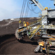 Gray wheel mining coal excavator - Stock Photo