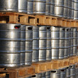 Stock Photo: Stock of steel kegs on wooden palettes