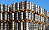 Stock of steel kegs of beer in factory yard — Stock Photo