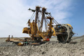 Huge yellow overbuden excavator in brown coal mine — Stock Photo