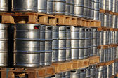 Stock of steel kegs on the wooden palettes — Stock Photo