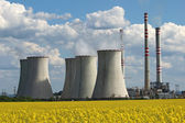 Coolin tower and chimney of coal power plant over yellow field — Stock Photo