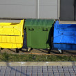 Three plastic big trash recycling bins on the street — Stock Photo