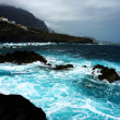 Dark island and see of canarian island  tenerife - Stock Photo