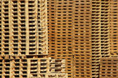 Many wooden pallet store on factory yard — Stock Photo