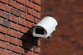 Security cctv camera on brick wall facade — Stock Photo