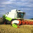 Harvest machine working on the field — Stock Photo