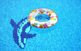 Delphin and swimming ring — Stock Photo