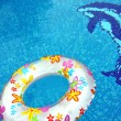 Ring and dolphin in swimmingpool — Stock Photo