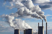 Smoking cooling towers of coal power plant — Stock Photo