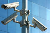 Three CCTV security cameras — Stock Photo