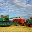 Stock Photo: Harvester machine load trailer