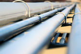 Steel pipe in oil refinery — Stock Photo