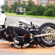 Motorbike accident on city street - Stock Photo