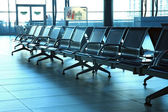 Seats from metal in airport hall — Stock Photo