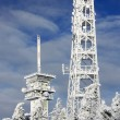 Royalty-Free Stock Photo: Snowy tv tower high in mountains