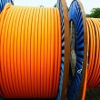Stock Photo: Orange cable on steel spool