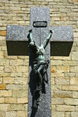 Crucifix and jesus on front of church — Stock Photo