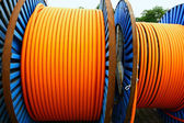 Orange cable on steel spool — Stock Photo