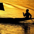 Shikara on dal lake during sunset - Stock Photo