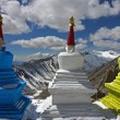Three stupas high in Himalayas - Stock Photo