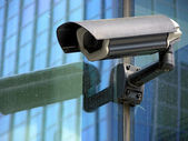 Cctv security camera on the glass facade — Foto Stock