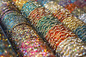 Bright colorful bangles — Stock Photo