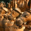 Terracotta clay unglazed ceramic horses - Stock Photo