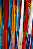 Many colored hammocks hang together in the shop — Stok fotoğraf