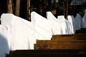 Church stairs and white surounding wall — Stock Photo
