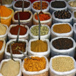 Stock Photo: Many colorful spice in small bags and spoons