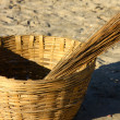 Close meshed bamboo hand made basket on sand — Stock Photo