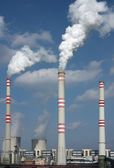 Detail of coal power plant with chimney and cooling towers — Stock Photo