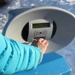 Girl hand close to turnstile machine during winter ski — Stock Photo