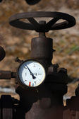 Detail of steel old valve with manometer — Stock Photo