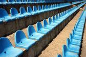 Blue plastic empty seats on football stadium — Stock Photo