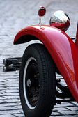 Old red vintage car in downtown of Prague — Stock Photo