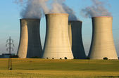 Power plant four cooling towers in agriculture field — Stock Photo