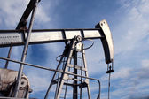 Silver pumpjack in crude oil field mine — Stock Photo
