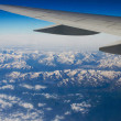 Mountains under the wing — Stock Photo