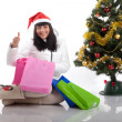 Beautiful woman at the Christmas tree with gifts — Stock Photo