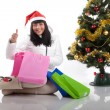 Beautiful woman at the Christmas tree with gifts — Stock Photo #37363355