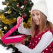 Girl with gifts near a Christmas tree — Stock fotografie