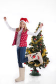 Girl in boots in Christmas tree — Stock Photo